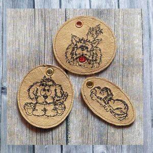Three ITH doodle dog key fobs 1010