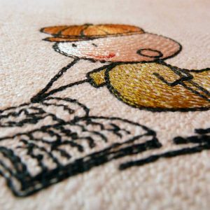 embroidery Wolly reading detail 1